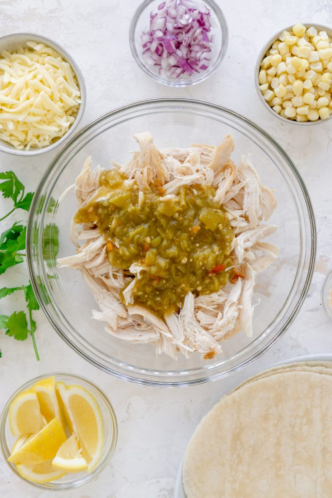 ingredients - chicken, cheese, red onion, corn, lemons, tortillas