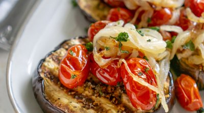 baked eggplant steaks on a plate with a fork