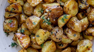 roasted garlic potatoes in a white bowl