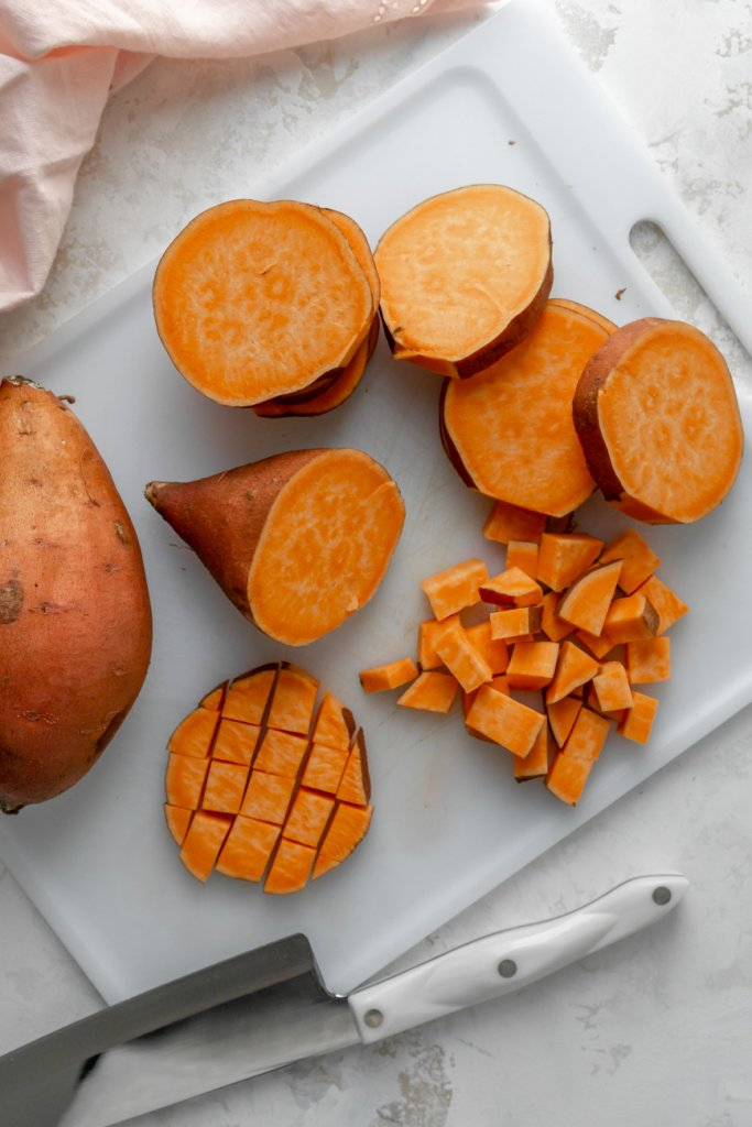 cutting a sweet potato