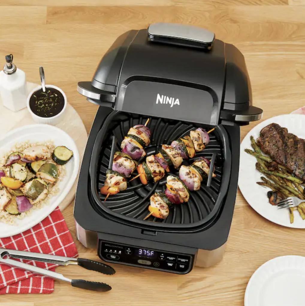 ninja foodi grill with kabobs and tongs