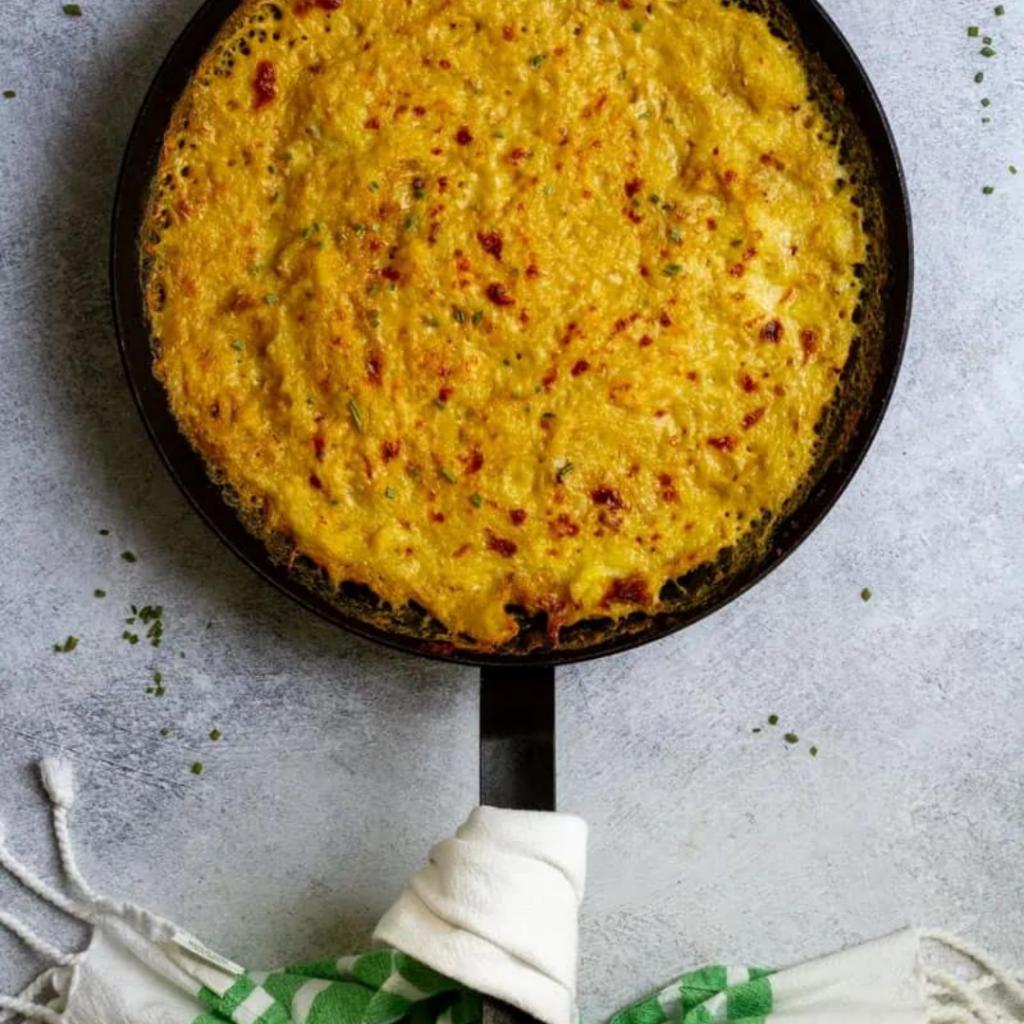spaghetti squash gratin in a black pan