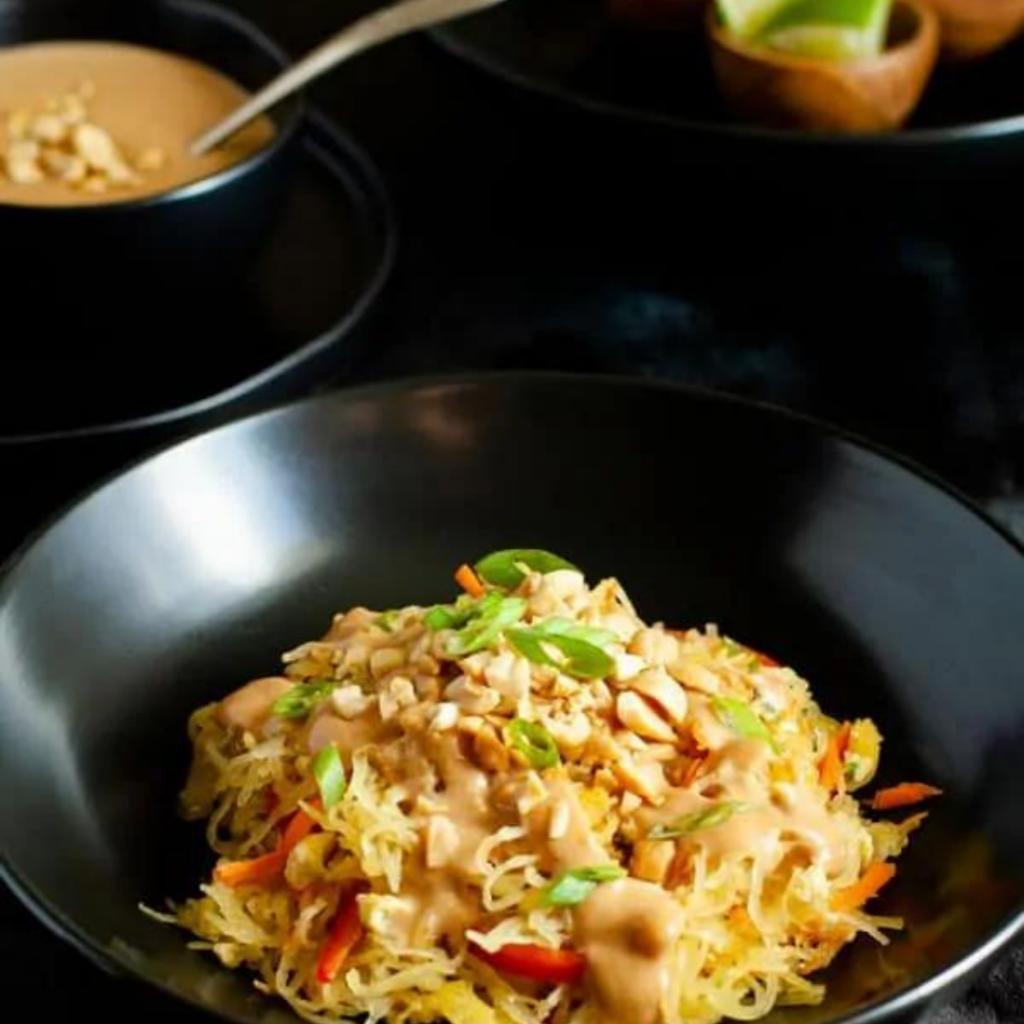 spaghetti squash pad thai in a black bowl