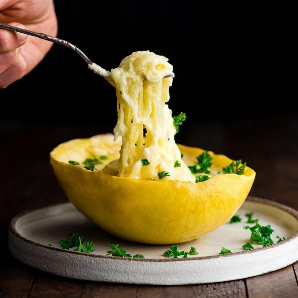 spaghetti squash mac and cheese on a white plate