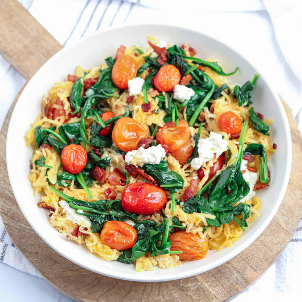 Spaghetti squash with bacon, goat cheese & spinach skillet