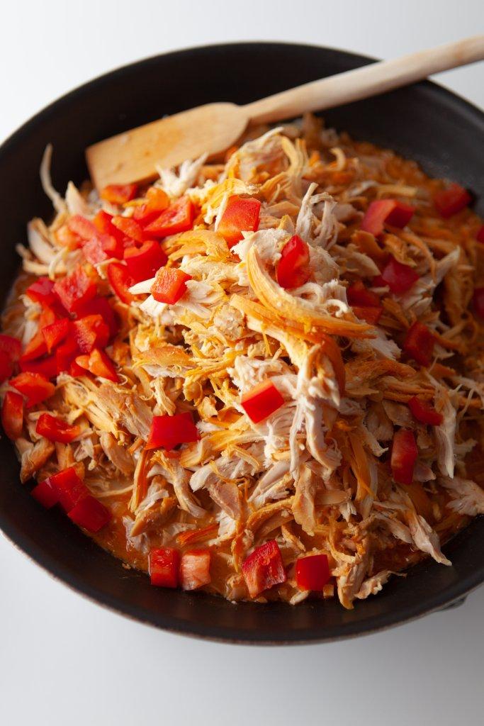 chicken empanada filling in a black bowl