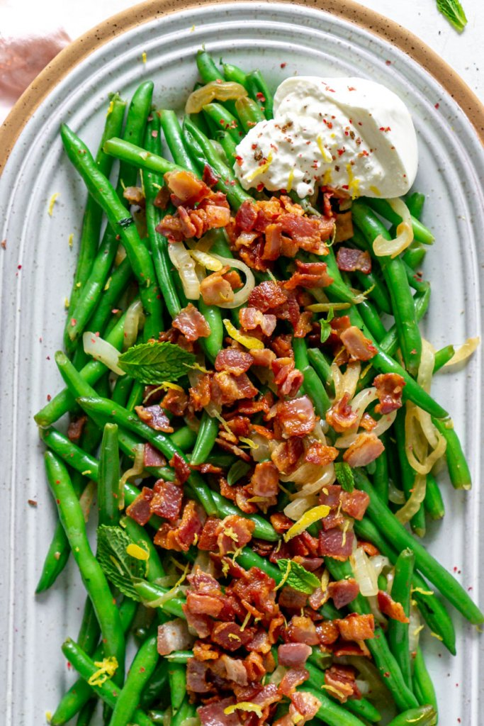 green beans and bacon with burrata on a serving tray