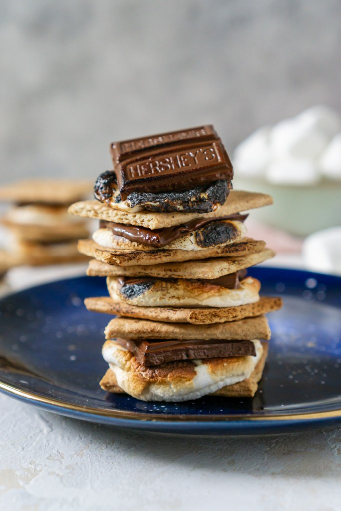 oven baked s'mores stacked on a blue plate