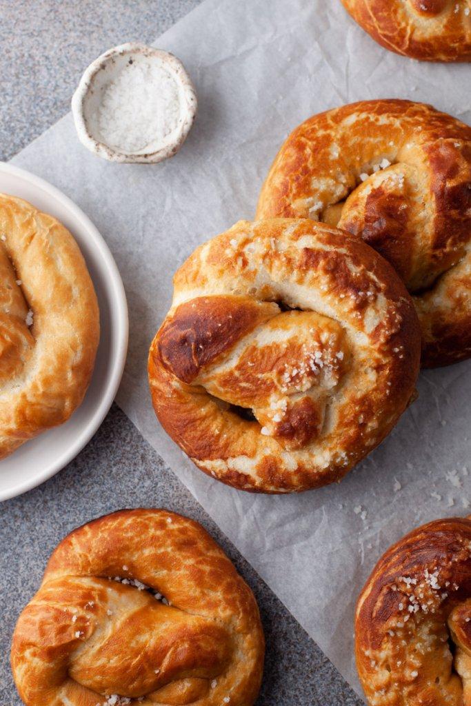 soft pretzels on parchment paper with pretzel salt