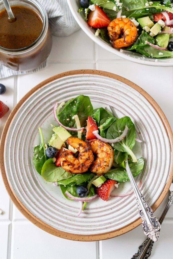 salad on a white plate with shrimp