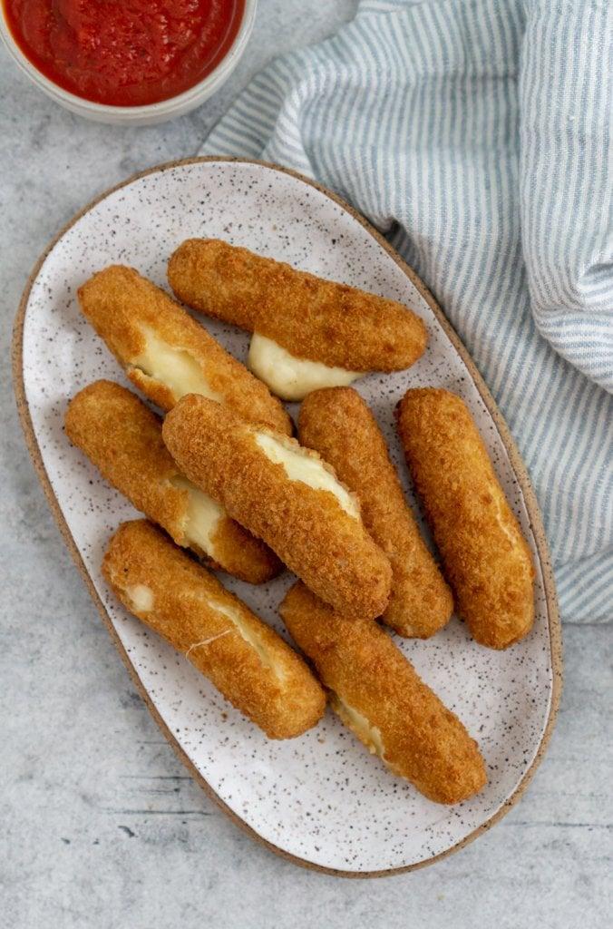 air fryer frozen mozzarella sticks on a plate