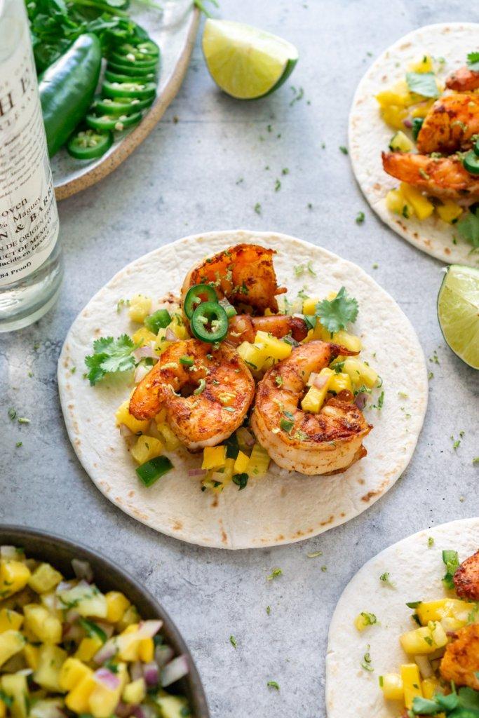 3 spicy shrimp tacos with salsa