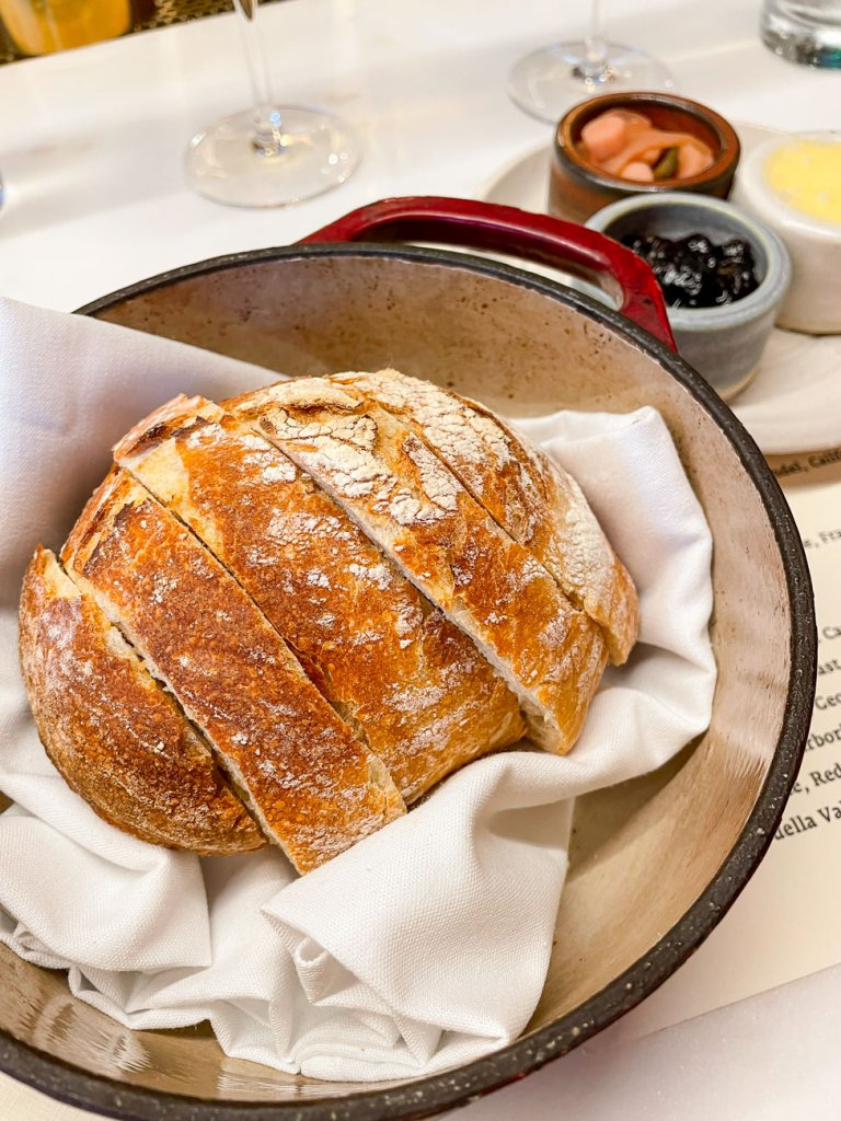 A loaf of sourdough bread in a dutch oven