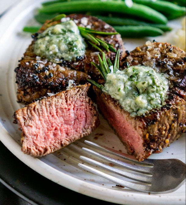 filet mignon sliced open on a plate