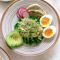 hummus breakfast bowl with eggs and avocado